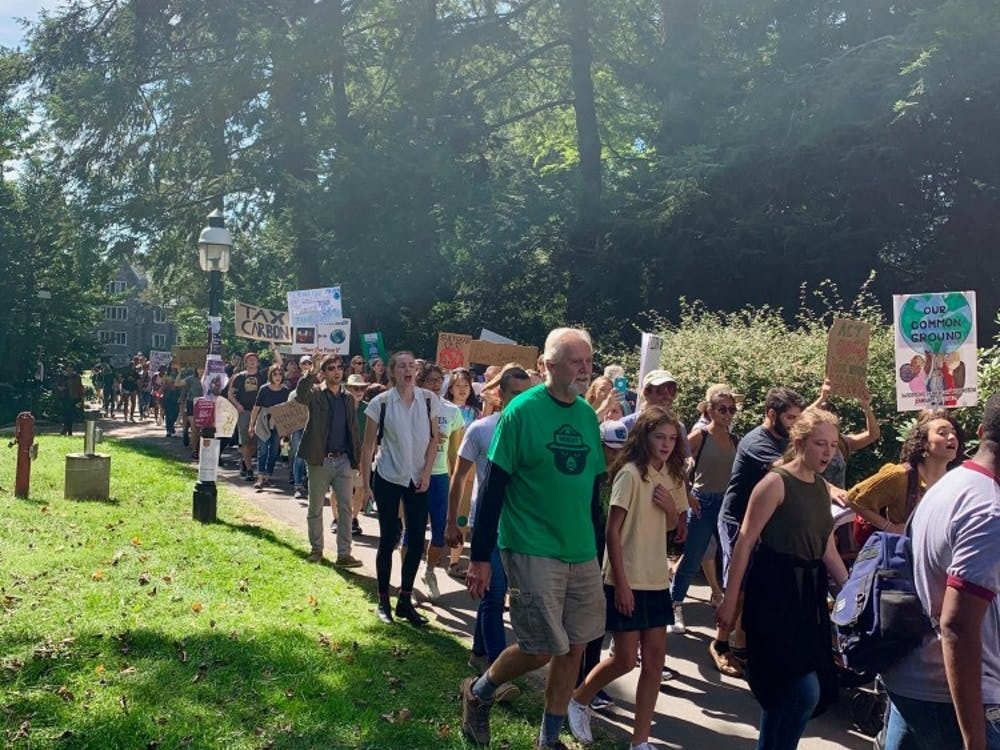 """Demonstrators march past Frist, chanting """"This is what democracy looks like!"""" and carrying signs.   Rose Gilbert / The Daily Princetonian"""