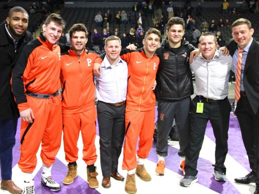 Kolodzik, Brucki, and Glory pose with their coaches after placing at the Midlands Championship