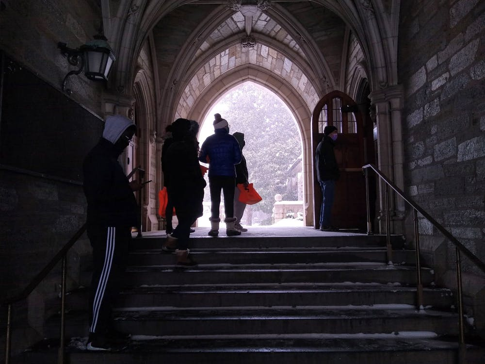 <h5>Students line up outside of the Rockefeller College Dining Hall on Feb. 1.</h5> <h6>Mark Dodici / The Daily Princetonian</h6>