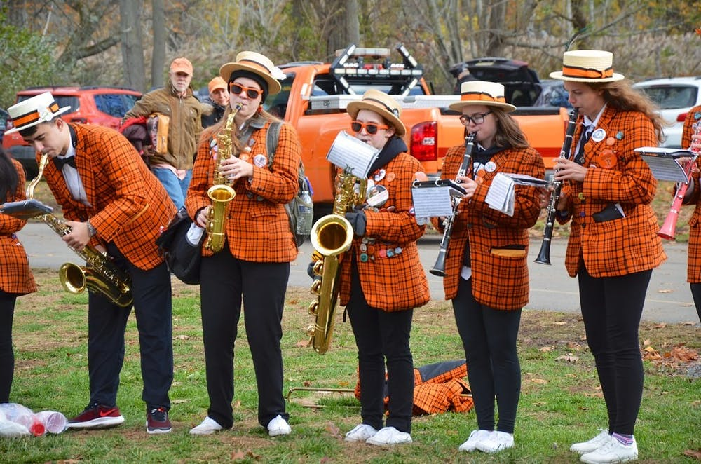 """<h5>Princeton Band at a tailgate in New Haven prior to a Princeton-Yale football game.</h5> <h6>""""Princeton Band At The Tailgate"""" by Joe Shlabotnik / <a href=""""https://www.flickr.com/photos/joeshlabotnik/49993216733"""" target=""""_self"""">CC-SA 2.0</a></h6>"""