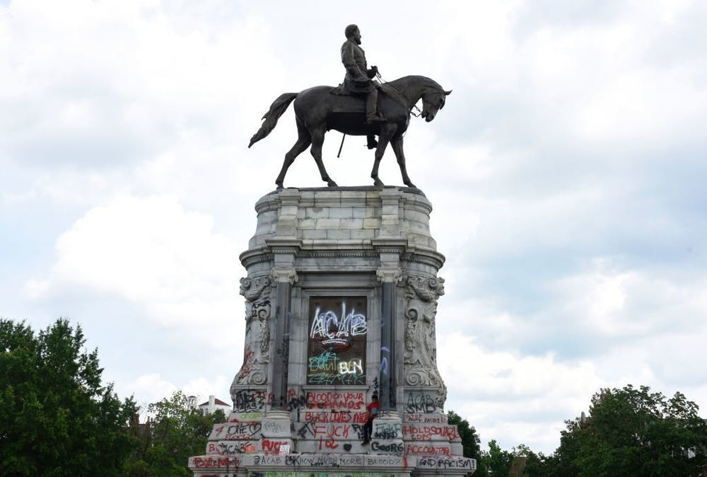 RICHMOND, VIRGINIA - JUNE 06:  Protesters gather around the statue of Confederate General Robert E. Lee on Monument Avenue on June 6, 2020 in Richmond, Virginia, amidst protests over the death of George Floyd in police custody. Virginia Gov. Ralph Northam (D) announced plans to remove the statue.  (Photo by Vivien Killilea/Getty Images)