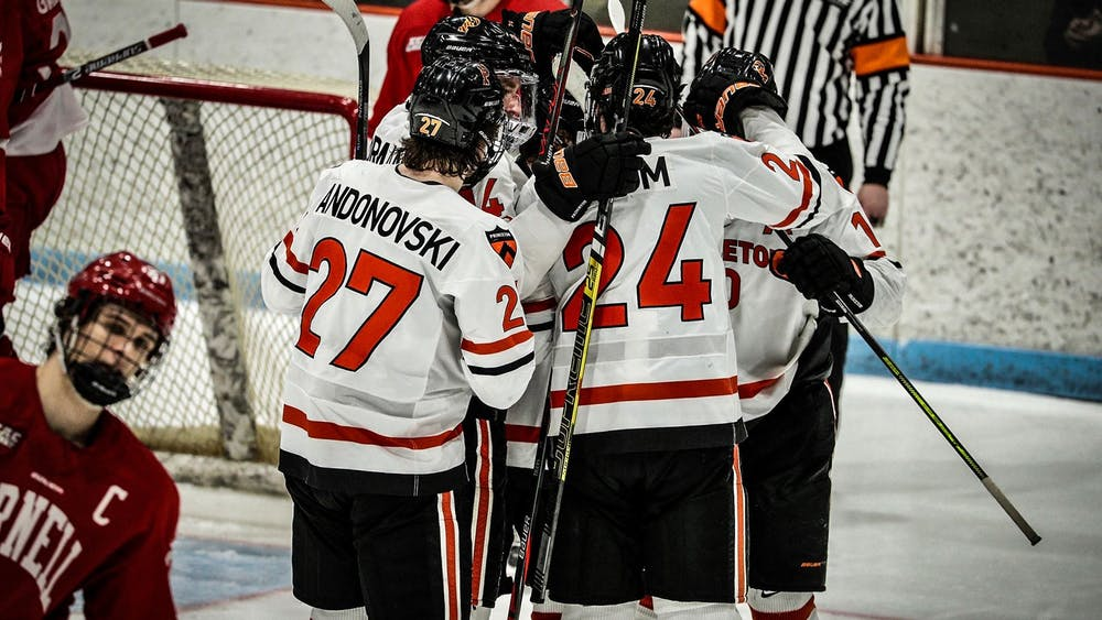 <p>The Tigers gather in a huddle during the Cornell game.</p> <h6>Photo Courtesy of Shelley M. Szwast / GoPrincetonTigers.com</h6>