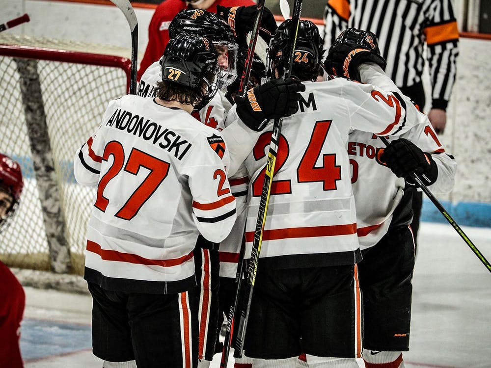 The Tigers gather in a huddle during the Cornell game. Photo Courtesy of Shelley M. Szwast / GoPrincetonTigers.com