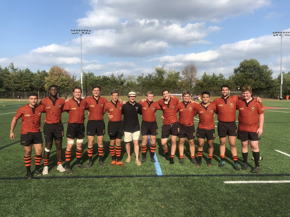 Princeton rugby's coaches and seniors following the match at Rutgers. Photo Credit: Princeton rugby