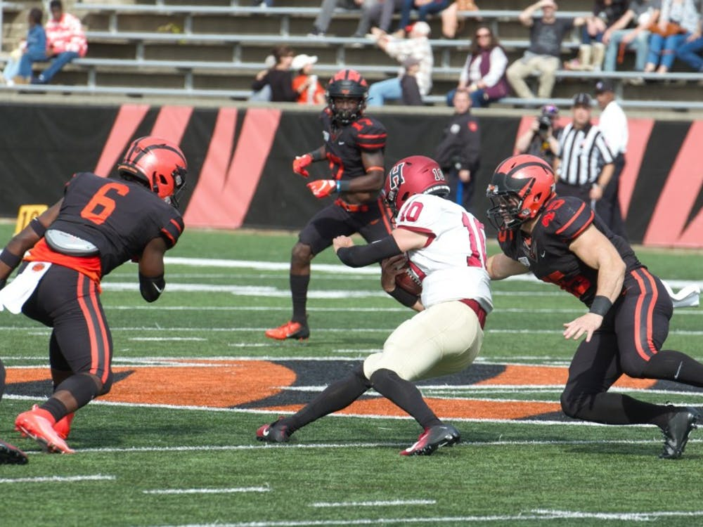 James Johnson tackles Harvard QB Jake Smith in the first half of Princeton's win over Harvard. Photo Credit: Jack Graham / The Daily Princetonian