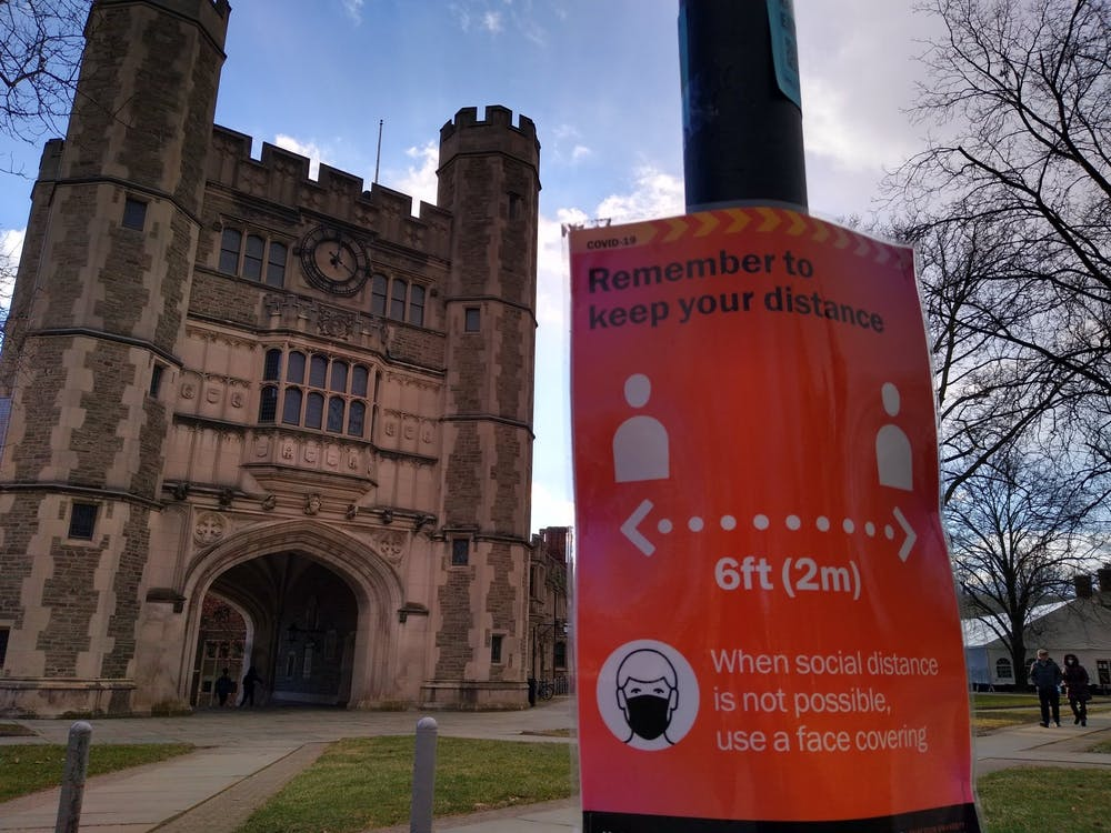 <h5>A sign promoting social distancing in front of Blair Arch.</h5> <h6>Mark Dodici / The Daily Princetonian</h6>