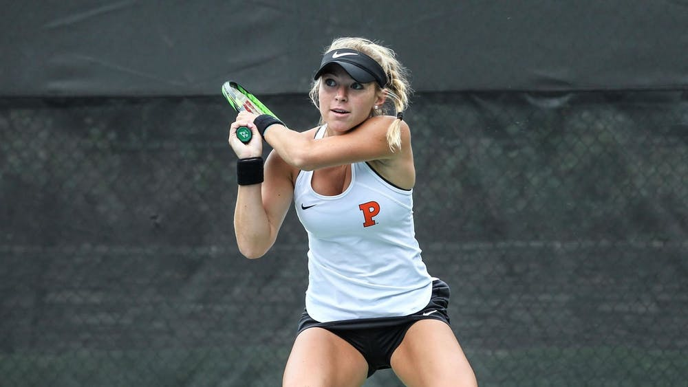 Credit: Beverly Schaefer / goprincetontigers.com Caption: Gracie Joyce follows through after shot during her doubles match at the Blue Gray Classic.