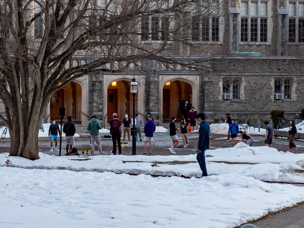 Students enjoy Wednesday's warmer weather with games of Spikeball in front of Dillon Gym.  Candace Do / The Daily Princetonian