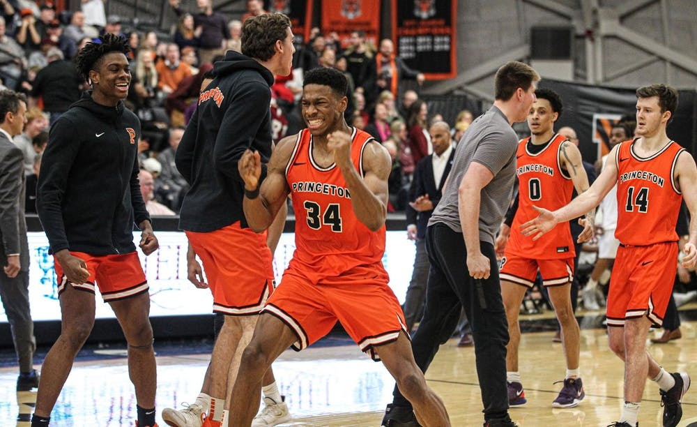 <p>Men's basketball celebrates after a nail-biting win against Harvard.&nbsp;</p> <p>Photo credit: Beverly Schaefer, GoPrincetonTigers</p>