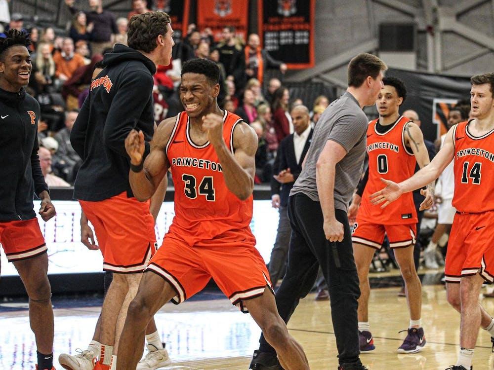 Men's basketball celebrates after a nail-biting win against Harvard. Photo credit: Beverly Schaefer, GoPrincetonTigers