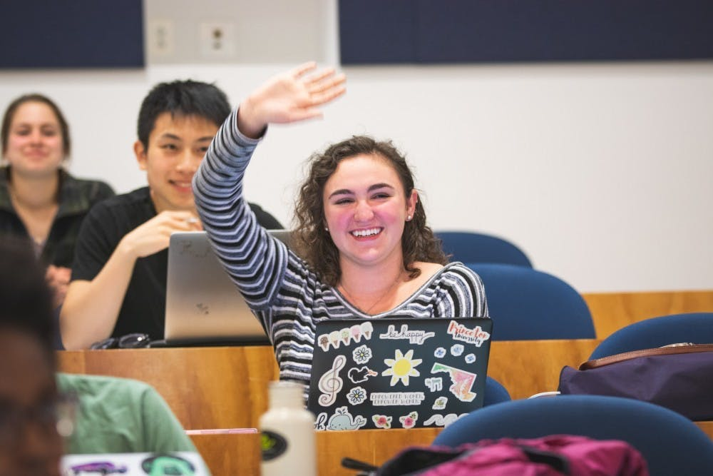 <p>Rachel Hazan '21, who ran unopposed for the position of USG Treasurer, raises her hand at an April 2019 meeting.</p> <h6>Photo Credit: Brad Spicher / The Daily Princetonian</h6>