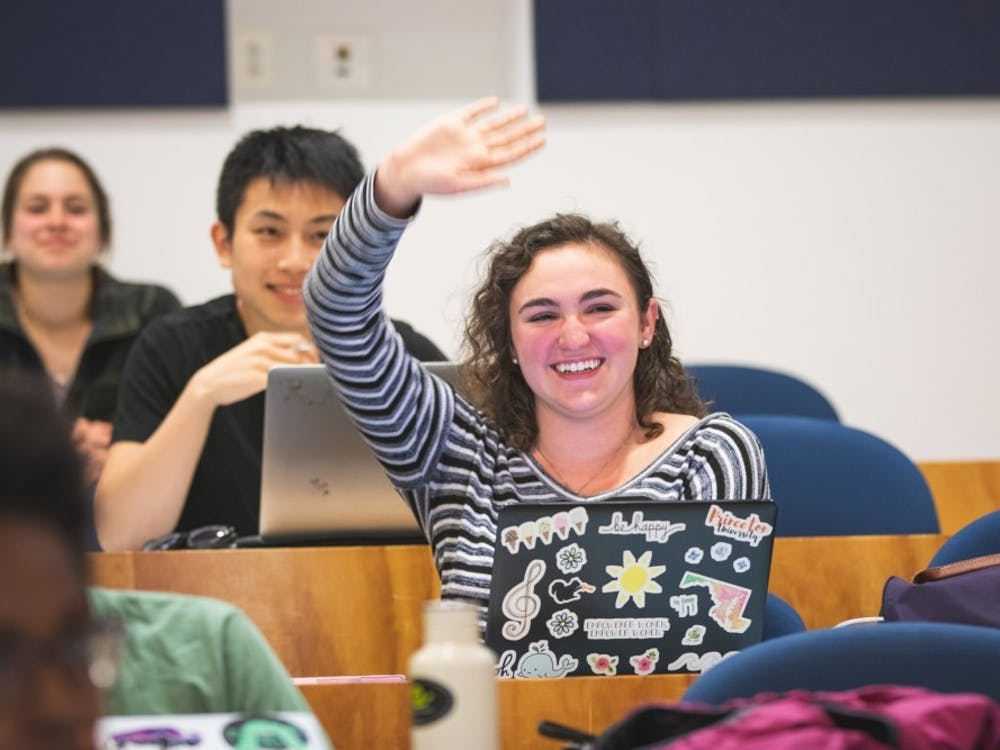 Rachel Hazan '21, who ran unopposed for the position of USG Treasurer, raises her hand at an April 2019 meeting. Photo Credit: Brad Spicher / The Daily Princetonian