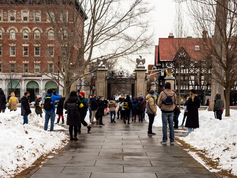 A protest outside FitzRandolph Gate on Saturday, Feb. 13 called for Princeton University to share its COVID-19 testing resources with residents of the town of Princeton and nearby communities.  Candace Do / The Daily Princetonian