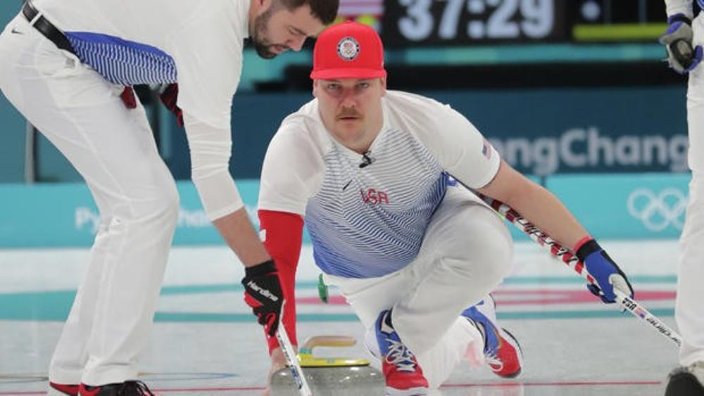 Feb 14, 2018; Gangneung, South Korea; Matt Hamilton (USA) throws a stone as John Landsteiner (USA) sweeps during men's curling round robin play in the Pyeongchang 2018 Olympic Winter Games at Gangneung Curling Centre. Mandatory Credit: Mark Hoffman-USA TODAY Sports