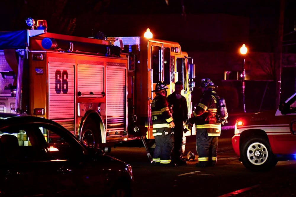 <p>Firefighters conferred outside of University Cottage Club.</p> <h6>Photo Credit: Jon Ort / The Daily Princetonian</h6>