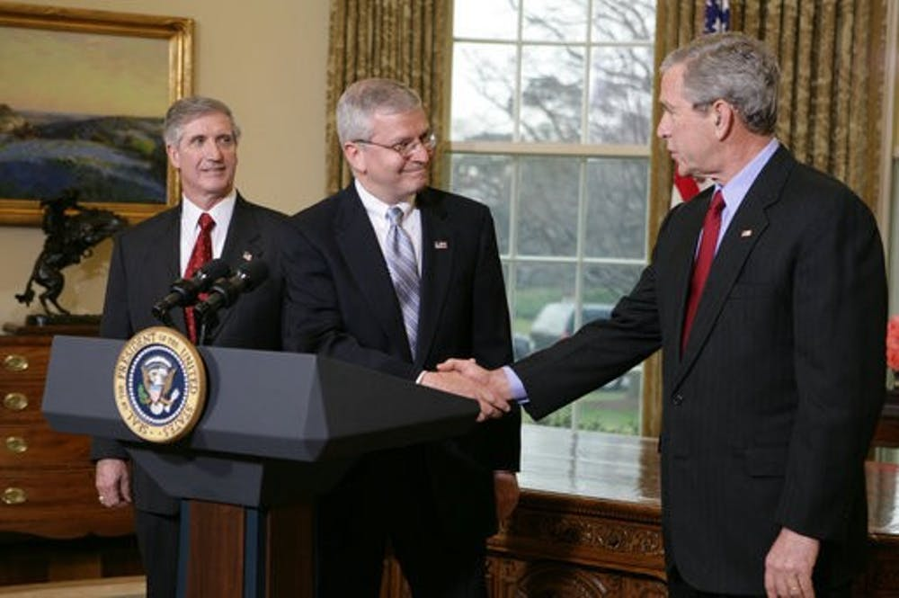 <h5>Joshua Bolten '76 shakes hands with President George W. Bush.</h5> <h6>David Bohrer / The White House</h6>