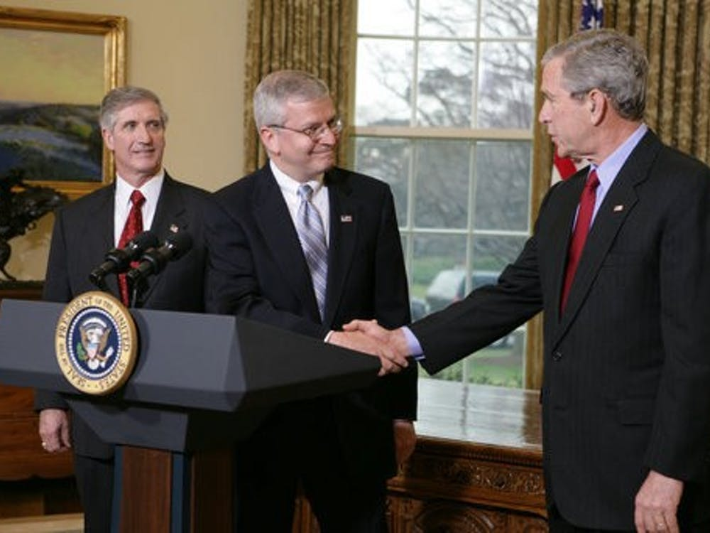 Joshua Bolten '76 shakes hands with President George W. Bush. David Bohrer / The White House