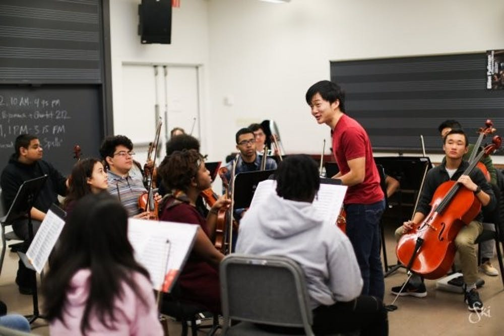 <p>Lou Chen '19 conducts the Trenton Youth Orchestra. Photo courtesy of Sonya Isenberg.</p>