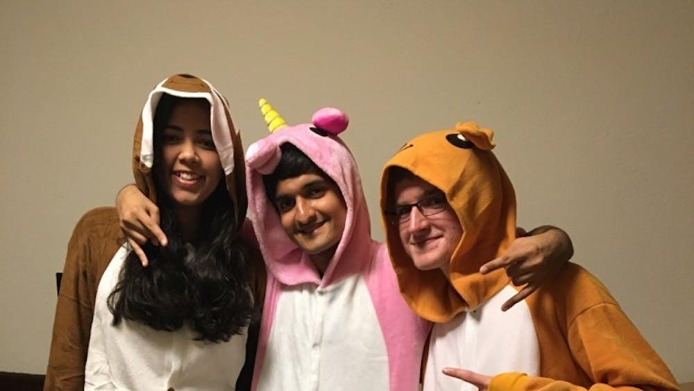 Neha Chauhan '21, Saket Shah '21, Joe Kawalec '21 dressed in onesies for Princetoween last fall.