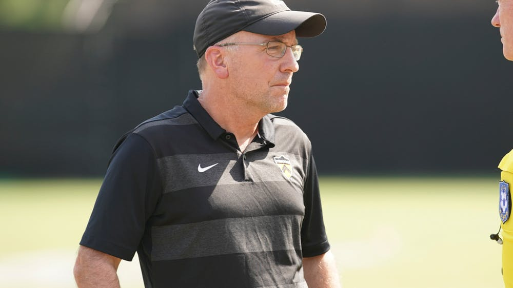 <h5>Head coach Jim Barlow on the soccer field.</h5> <h6>Courtesy of goprincetontigers.com</h6>