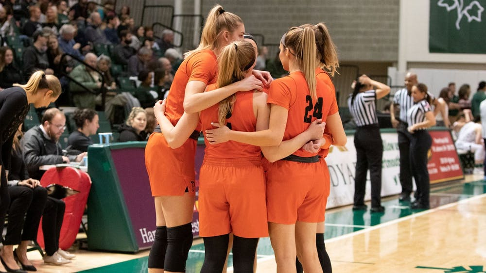 <p>The team huddles during their game against Dartmouth.</p> <h6>Photo Courtesy of Brian LaFountaine / GoPrincetonTigers</h6>