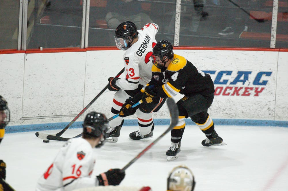 <p>Jeremy Germain battles for a puck against a Colorado College opponent.</p> <h6>Photo Credit: Jack Graham / The Daily Princetonian</h6>