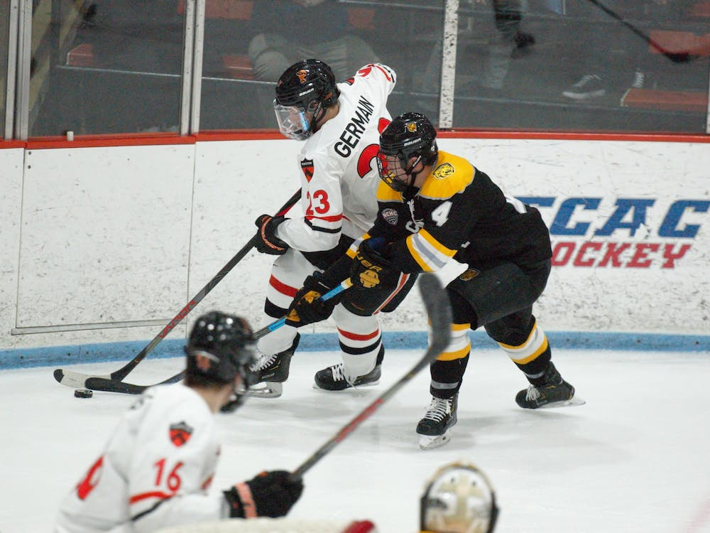 Jeremy Germain battles for a puck against a Colorado College opponent. Photo Credit: Jack Graham / The Daily Princetonian