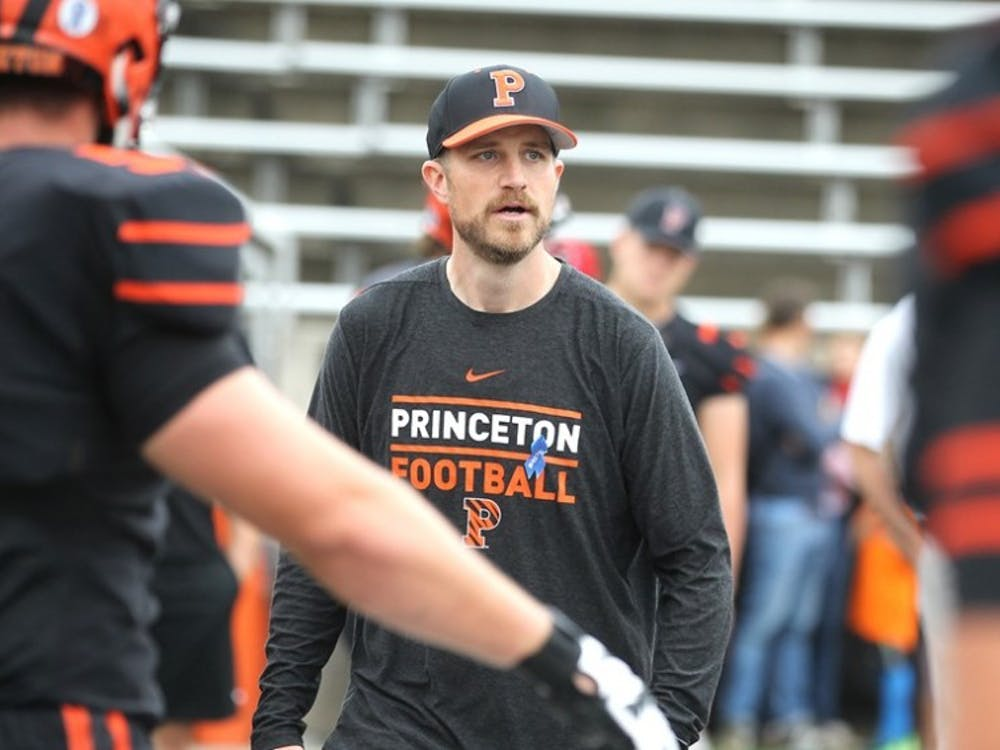 Caption: Offensive coach Andrew Aurich '06 pregame. Photo Courtesy of GoPrincetonTigers