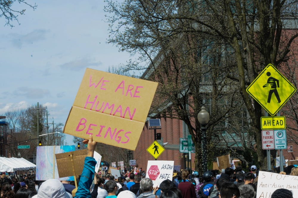 <h5>Crowds attended a Stop Asian Hate rally and vigil on Saturday in response to the killings in Atlanta earlier this month. Rally-goers held up homemade signs calling for the dismantling of systemic racism and asking for the community's support.</h5> <h6>Justin Cai / The Daily Princetonian</h6>