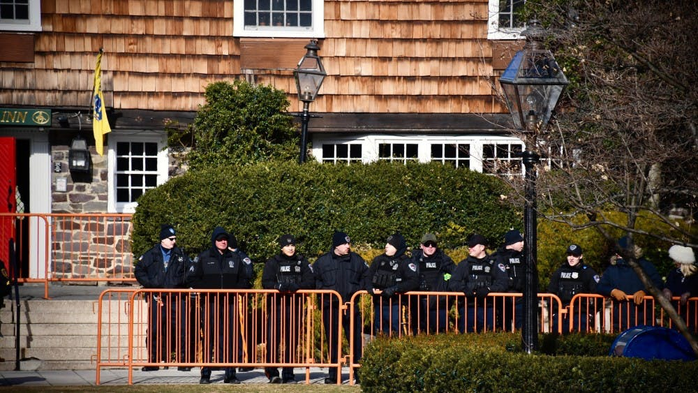 <p>A group of Princeton Police Department officers gather in front of the Nassau Inn.</p> <h6>Photo Credit: Jon Ort / The Daily Princetonian</h6>