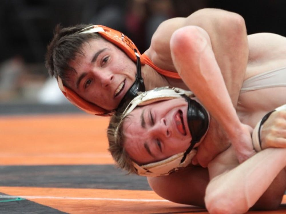 Freshman Pat Glory defeats his Brown opponent on Saturday.