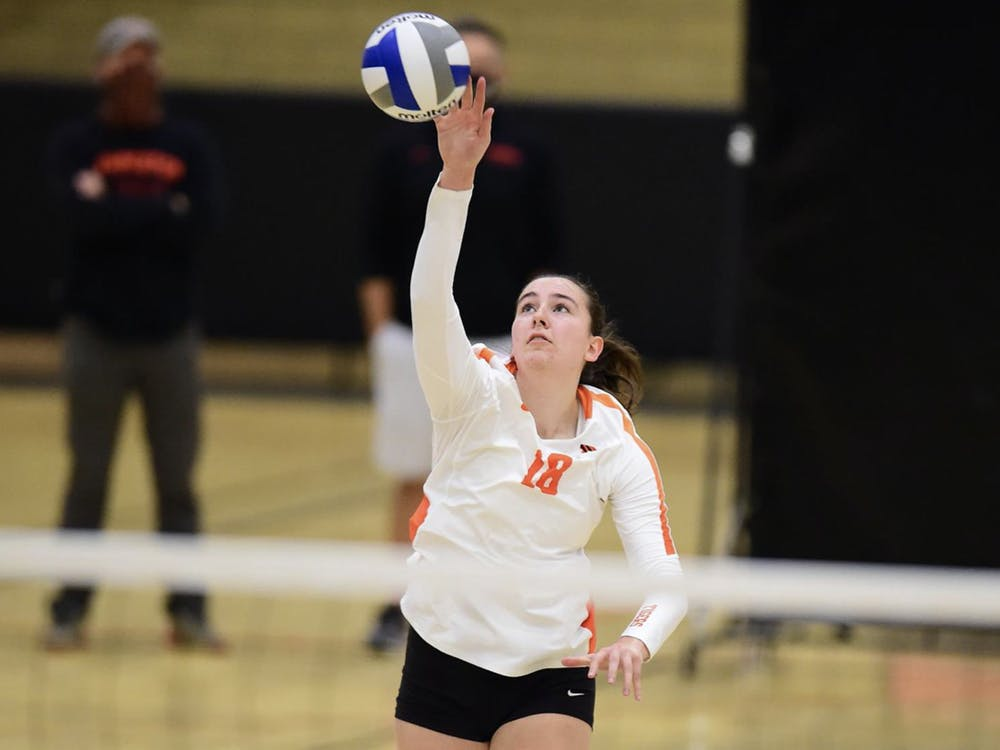 Avery Luoma goes in for the kill. Courtesy of GoPrincetonTigers.com