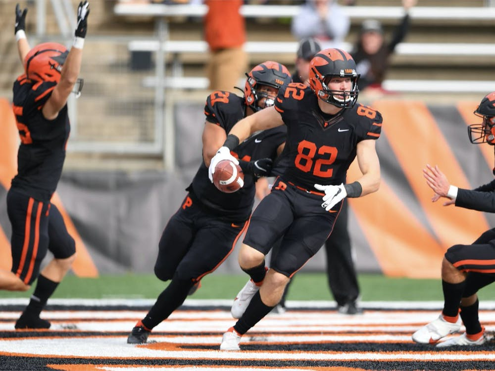 Senior wide receiver Cash Goodhart celebrates his touchdown off a blocked punt in Princeton's 18-16 five OT win over Harvard. Courtesy of GoPrincetonTigers.com