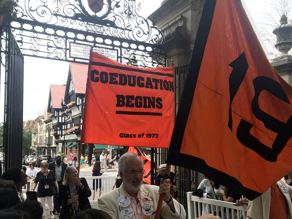 "Members of the Class of 1973 hold up a ""Coeducation Begins"" banner at the Pre-Rade. Photo Credit: Zachary Shevin / The Daily Princetonian"