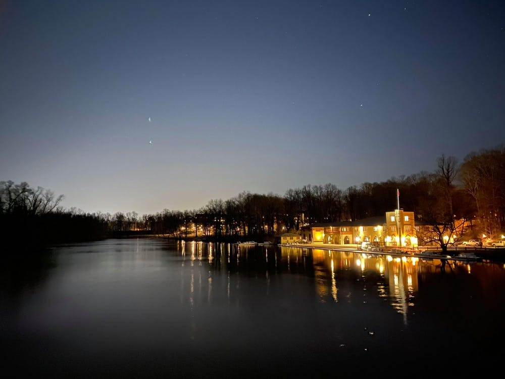 Shea Rowing Center glows brilliantly at midnight along Lake Carnegie. Justin Cai / The Daily Princetonian