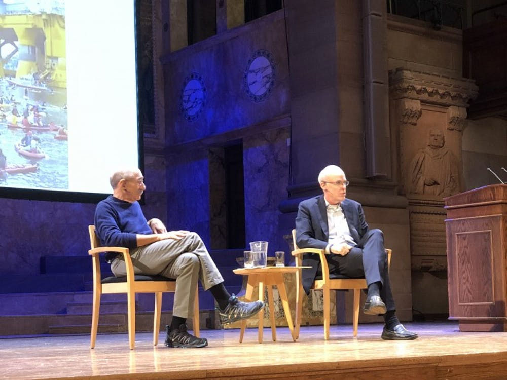 Moderator (left), Michael Oppenheimer, who is the Director of the Princeton Environmental Institute introduces the speaker and environmental activist, Bill McKibben (right).