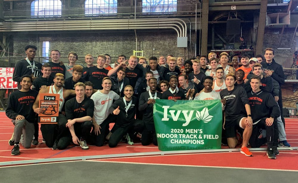 Caption: Men's track and field with the Ivy League Championship banner.  Credit: GoPrincetonTigers.com