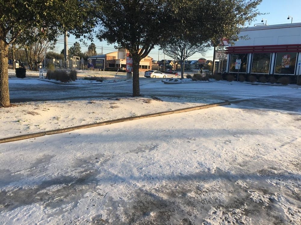 A thin layer of snow and ice covers the ground after unusual weather in Texas. Courtesy of Nafisa Ahmed '22