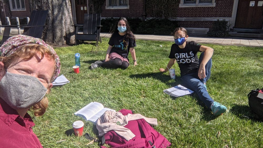 <h5>Students sit outside with Shira Kahn, C<strong>o-Director and Torah Educator of OU Seif Jewish Learning Initiative</strong></h5> <h6><strong>Courtesy of Debra Orel, Event and Marketing Manager for the Center for Jewish Life</strong></h6>