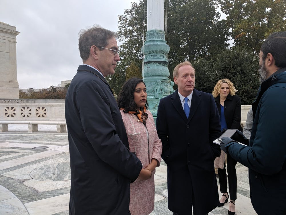 Chris Eisgruber '83, Maria De La Cruz Perales Sanchez '18, and Brad Smith '81 speak to reporters outside of the U.S. Supreme Court. Photo Credit: Benjamin Ball / The Daily Princetonian