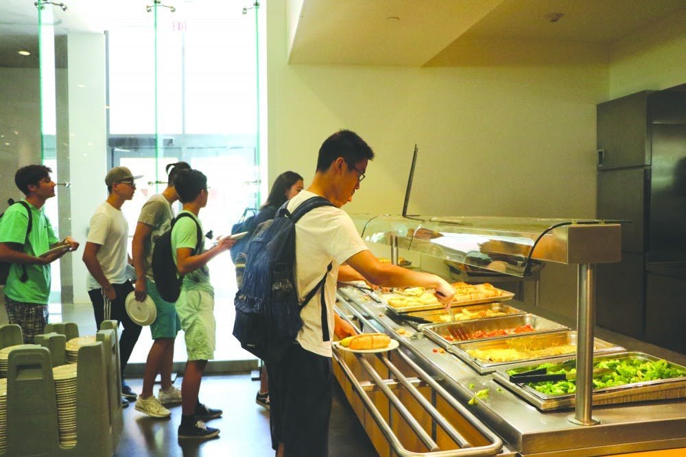 students_getting_food_in_servery_xinyu_chen_col