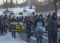 Students march on campus while holding banners and signs from their organizations during the March for Humanity. The march followed a ceremony with speakers including Pennsylvania state Sen. Vincent Hughes. This was the 32nd anniversary of the march, which was created to honor Martin Luther King Jr.