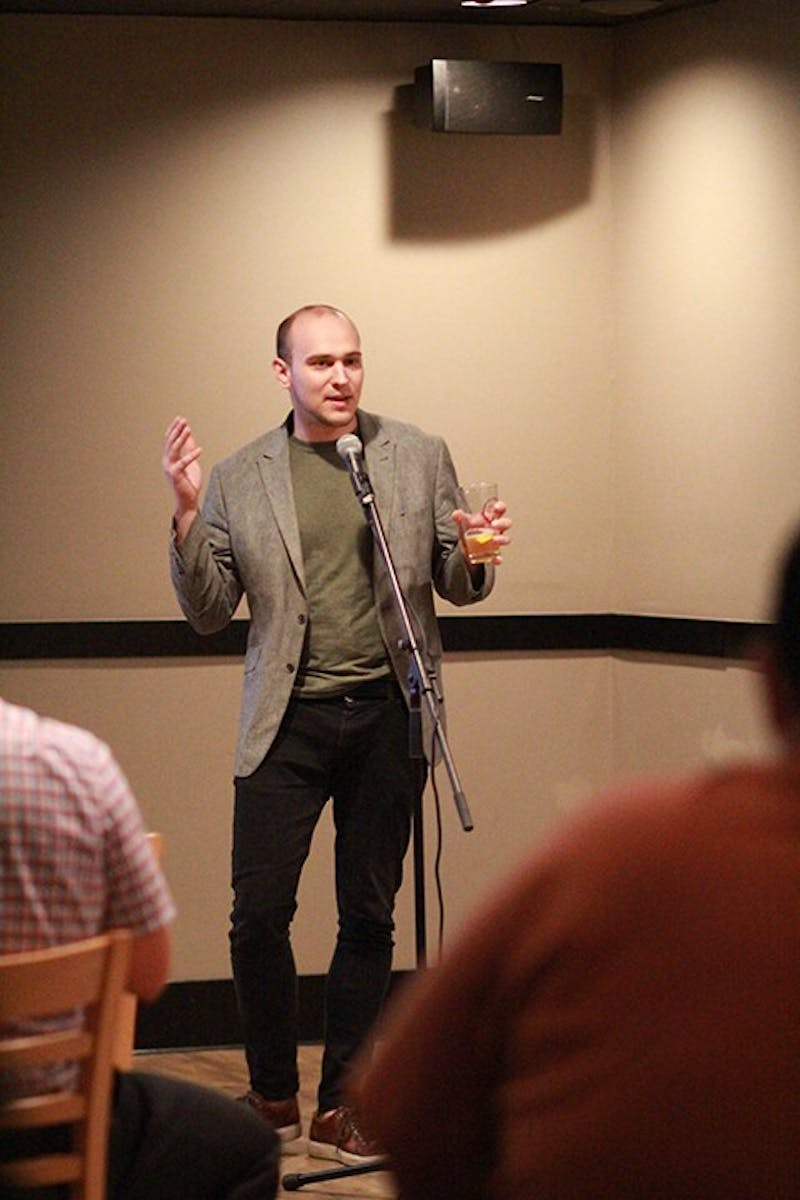 Andrew Burdge won the first Story Slam with a story about his childhood.