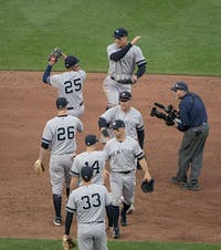 The Yankees celebrate an early-season road victory over the Baltimore Orioles. New York has clawed its way to a 19-14 start despite having 13 players on the injured list, including stars Aaron Judge and Giancarlo Stanton.