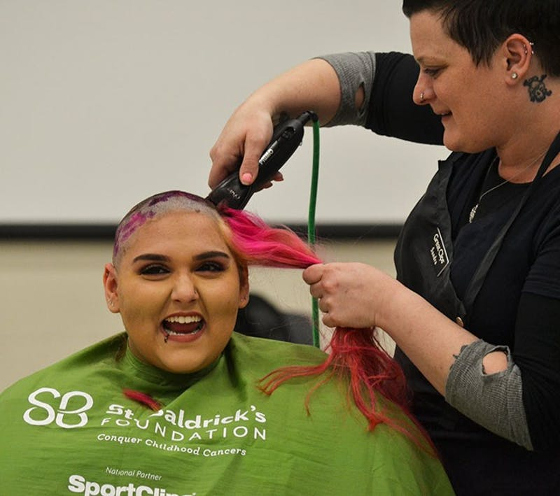 SU students volunteer to get their heads shaved in honor of cancer patients who have lost their hair because of treatments.