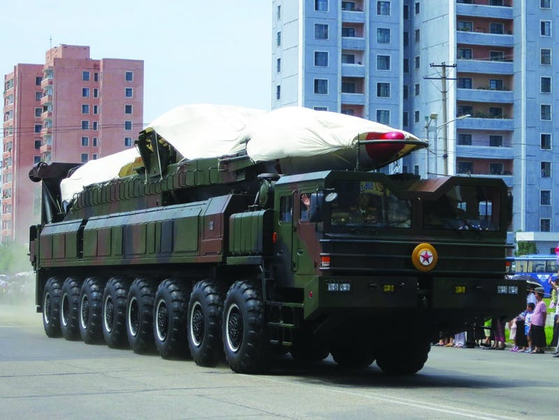 Members of the Korean People's Army parade a ballistic missile through the streets of Pyongyang, North Korea, during North Korea victory day in 2013. The celebration marks the anniversary of the Korean Armistice Agreement.