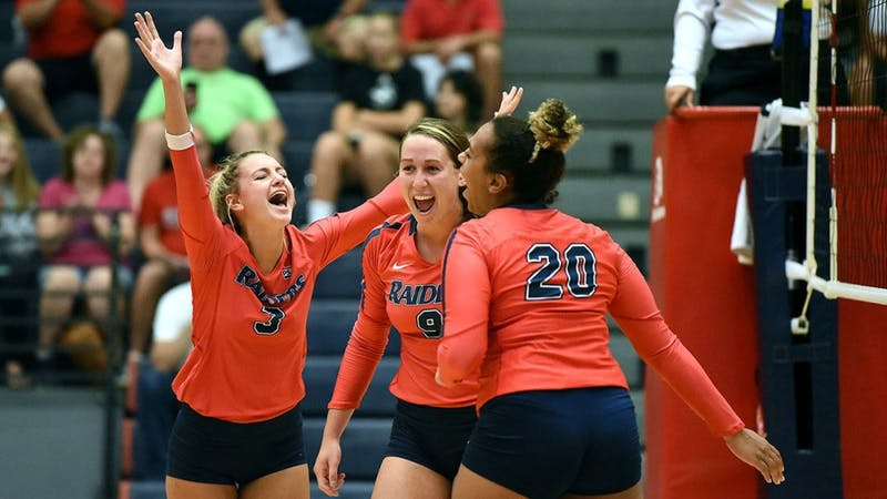 Maria Lucas, Gabriella Johnson and Kendall Johnson (left to right) celebrate during a home match at Heiges Field House.