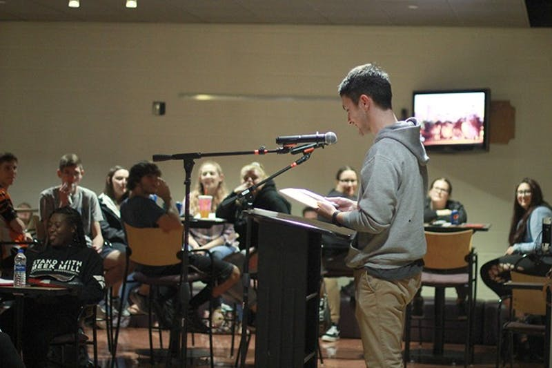 Junior English major Luke Hershey read poems from his childhood memories aloud at the Open Mic Night on Sept. 30 in McFeely's Cafe.