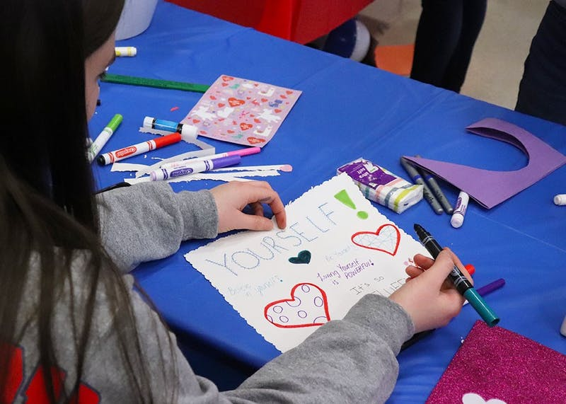 One SU student creates a Valentine card filled with encouraging words.
