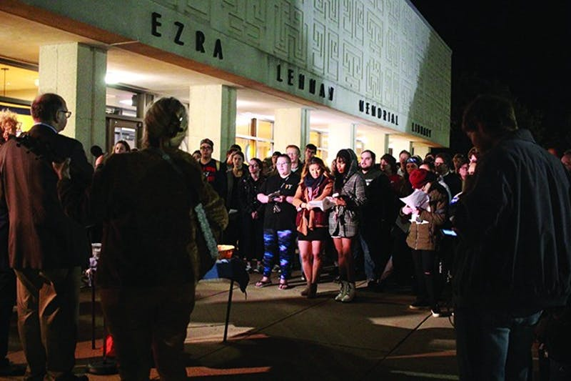 Members of the Shippensburg community gather outside of the Ezra Lehman Memorial Library for a candlelight vigil after the Tree of Life Synagogue shooting on Oct. 27. Students and professors spoke at the vigil and expressed frustrations, but also shared messages of hope for the Jewish community.